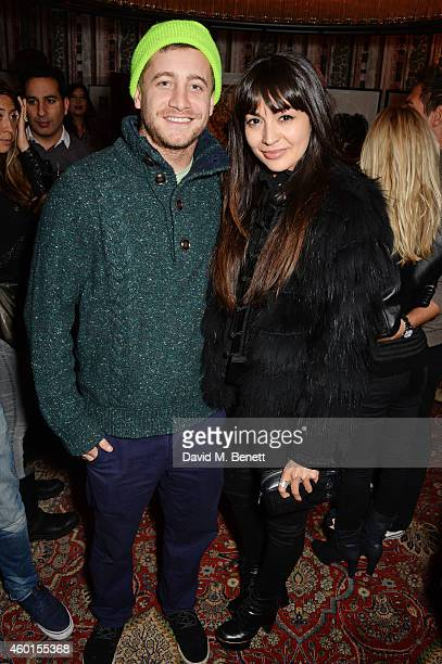 Tyrone Wood and Zara Martin attend a VIP screening of 'St Vincent' hosted by Poppy Delevingne at The Covent Garden Hotel on December 8 2014 in London...