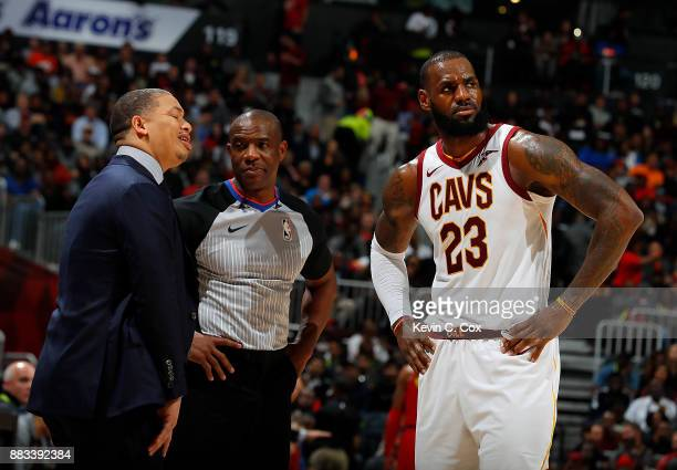 Tyronn Lue and LeBron James of the Cleveland Cavaliers react towards referee Tony Brown after James was charged with a foul against the Atlanta Hawks...