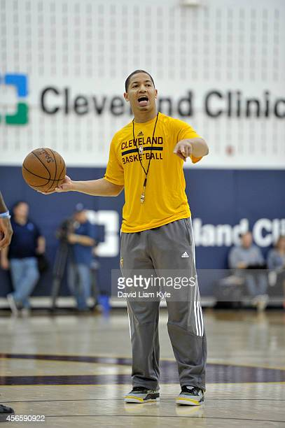 Tyronn Lue Assistant Coach of the Cleveland Cavaliers calls a play during a practice at The Cleveland Clinic Courts on September 30 2014 in...