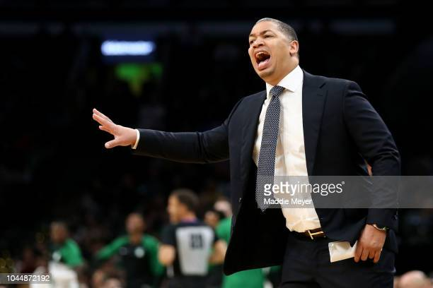 Tyronn Lue head coach of the Cleveland Cavaliers directs his team during the preseason game against the Boston Celtics at TD Garden on October 2 2018...