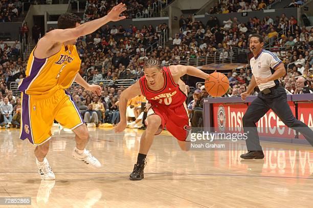 Tyronn Lue of the Atlanta Hawks drives against Jordan Farmar of the Los Angeles Lakers on December 8 2006 at Staples Center in Los Angeles California...