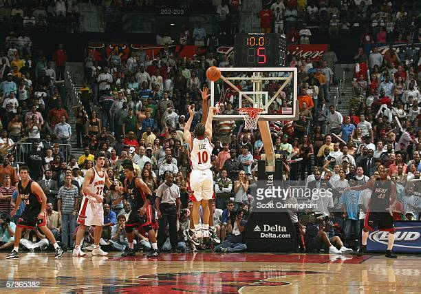 Tyronn Lue of the Atlanta Hawks hits the game winning shot against the Miami Heat on April 18 2006 at Philips Arena in Atlanta Georgia NOTE TO USER...