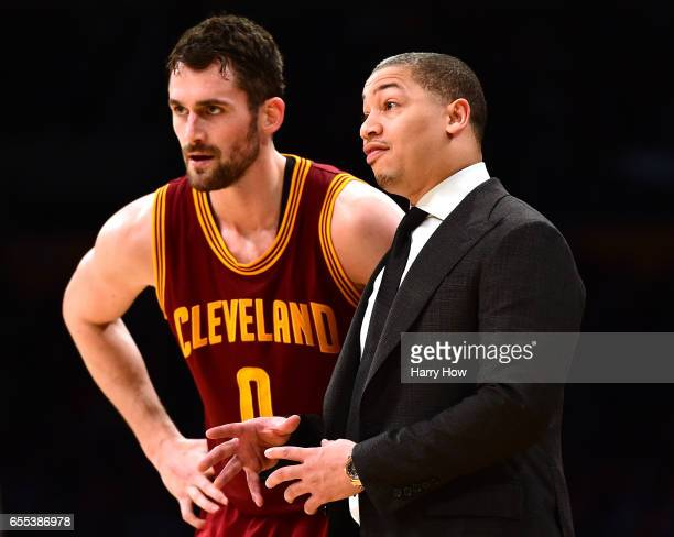 Tyronn Lue of the Cleveland Cavaliers and Kevin Love react to play during the first half against the Los Angeles Lakers at Staples Center on March 19...