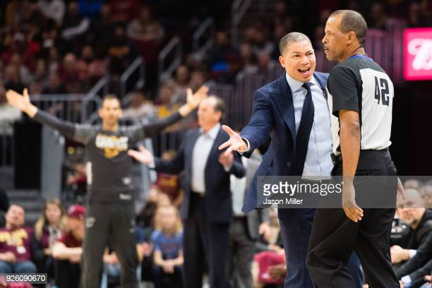 Tyronn Lue of the Cleveland Cavaliers argues a call with referee Eric Lewis during the first half against the Philadelphia 76ers at Quicken Loans...