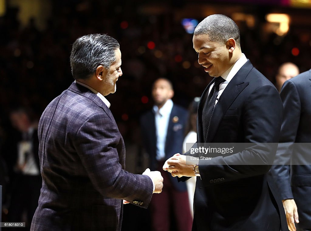 Tyronn Lue of the Cleveland Cavaliers receives his championship ring from owner Dan Gilbert before the game against the New York Knicks at Quicken Loans Arena on October 25, 2016 in Cleveland, Ohio.