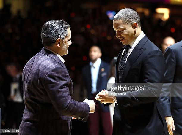 Tyronn Lue of the Cleveland Cavaliers receives his championship ring from owner Dan Gilbert before the game against the New York Knicks at Quicken...