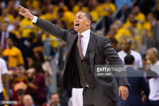 Tyronn Lue of the Cleveland Cavaliers yells to his players during the first half of Game One of the NBA Eastern Conference semifinals against the...