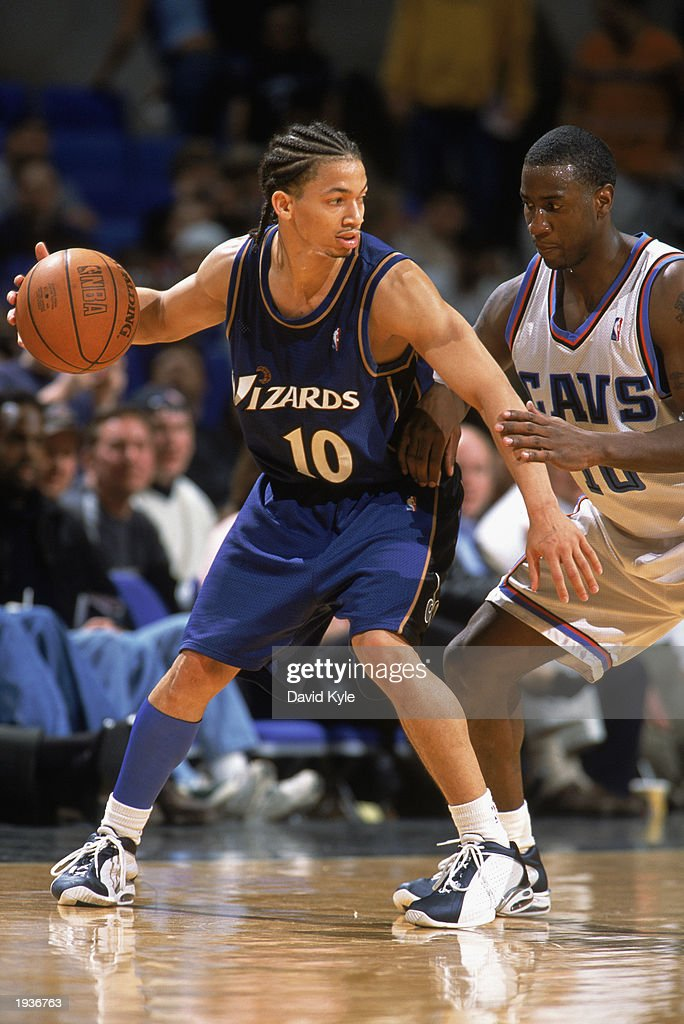 Tyronn Lue #10 of the Washington Wizards drives against Milt Palacio #10 of the Cleveland Cavaliers during the game at Gund Arena on April 8, 2003 in Cleveland, Ohio. The Wizards defeated the Cavaliers 100-91.