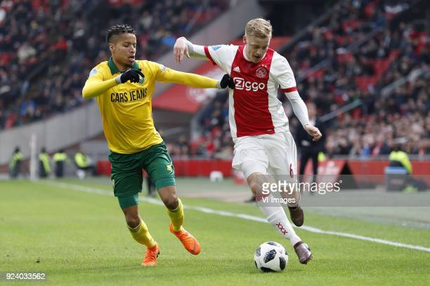 Tyronne Ebuehi of ADO Den Haag Donny van de Beek of Ajax during the Dutch Eredivisie match between Ajax Amsterdam and ADO Den Haag at the Amsterdam...