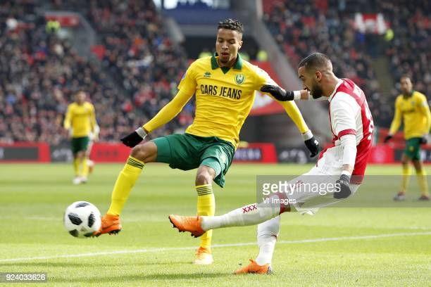 Tyronne Ebuehi of ADO Den Haag Hakim Ziyech of Ajax during the Dutch Eredivisie match between Ajax Amsterdam and ADO Den Haag at the Amsterdam Arena...