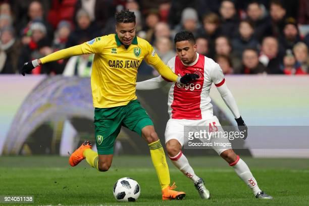 Tyronne Ebuehi of ADO Den Haag Justin Kluivert of Ajax during the Dutch Eredivisie match between Ajax v ADO Den Haag at the Johan Cruijff Arena on...