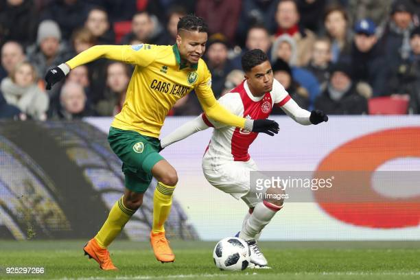 Tyronne Ebuehi of ADO Den Haag Justin Kluivert of Ajax during the Dutch Eredivisie match between Ajax Amsterdam and ADO Den Haag at the Amsterdam...