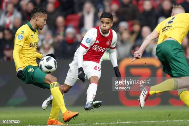 Tyronne Ebuehi of ADO Den Haag Justin Kluivert of Ajax Tom Beugelsdijk of ADO Den Haag during the Dutch Eredivisie match between Ajax Amsterdam and...