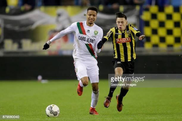 Tyronne Ebuehi of ADO Den Haag Mitchell van Bergen of Vitesse during the Dutch Eredivisie match between Vitesse v ADO Den Haag at the GelreDome on...
