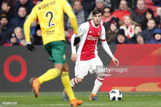Tyronne Ebuehi of ADO Den Haag Nico Tagliafico of Ajax during the Dutch Eredivisie match between Ajax Amsterdam and ADO Den Haag at the Amsterdam...