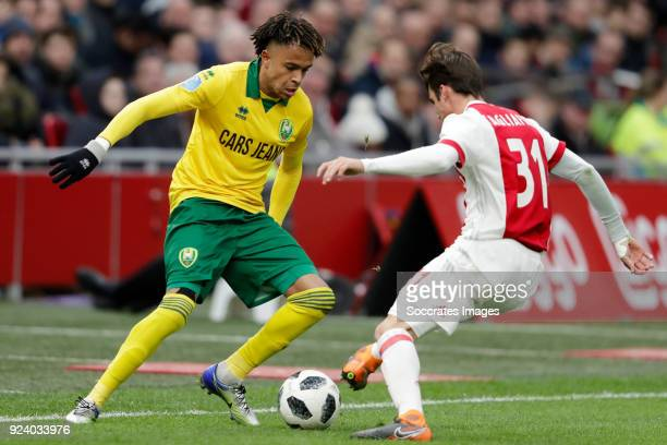 Tyronne Ebuehi of ADO Den Haag Nicolas Tagliafico of Ajax during the Dutch Eredivisie match between Ajax v ADO Den Haag at the Johan Cruijff Arena on...