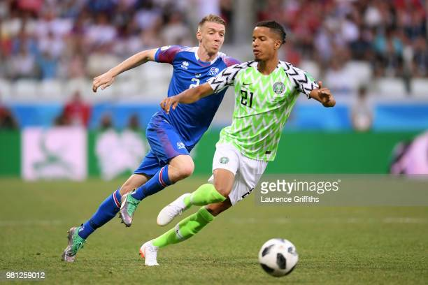 Tyronne Ebuehi of Nigeria is challenged by Birkir Saevarsson of Iceland during the 2018 FIFA World Cup Russia group D match between Nigeria and...