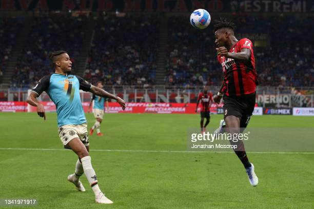 Tyronne Ebuehi of Venezia FC looks on as Rafael Leao of AC Milan heads the ball back across the face of the goal during the Serie A match between AC...
