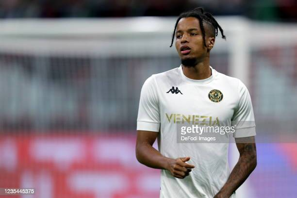 Tyronne Ebuehi of Venezia FC warm up prior to the Serie A match between AC Milan and Venezia FC at Stadio Giuseppe Meazza on September 22, 2021 in...