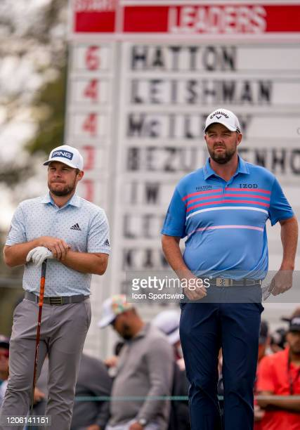 Tyrell Hatton and Marc Liishman on the leader board awaiting to tee off on the 11th hole during round final of the Arnold Palmer Invitational PGA...