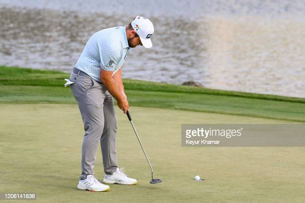 Tyrrell Hatton holes his winning par putt on the 18th hole green during the final round of the Arnold Palmer Invitational presented by MasterCard at...