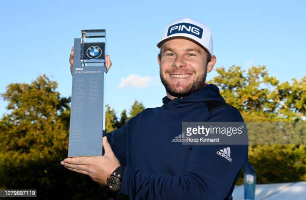 Tyrrell Hatton of England 1holding the winners trophy after the final round of the BMW PGA Championship at Wentworth Golf Club on October 11, 2020 in...