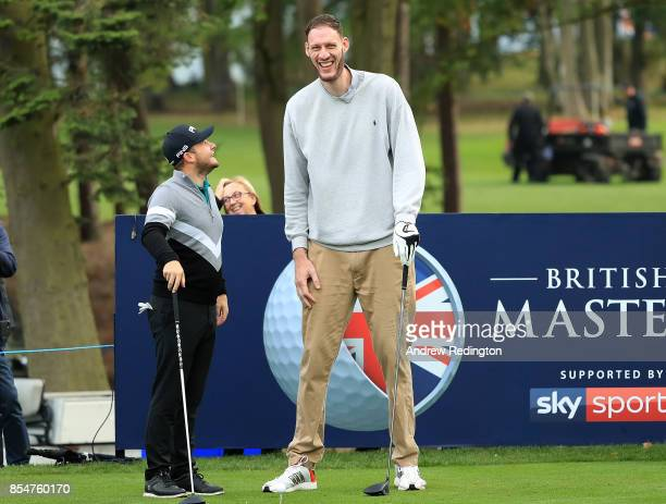 Tyrell Hatton of England and basketball player Paul Sturgess line up a shot during the pro am ahead of the British Masters at Close House Golf Club...