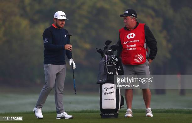 Tyrell Hatton of England and caddie Mick Donaghy look on during the ProAm of the WGC HSBC Champions at Sheshan International Golf Club on October 30...