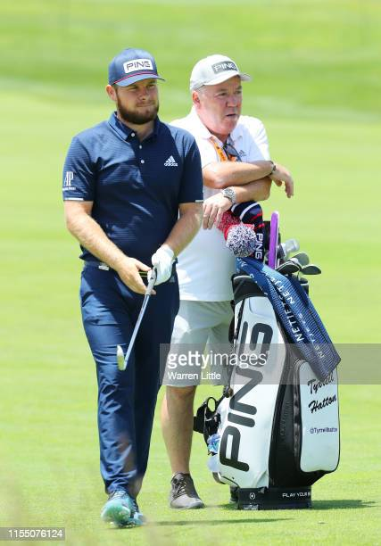 Tyrrell Hatton of England and caddie Mick Donaghy stand on the second hole during a practice round prior to the 2019 US Open at Pebble Beach Golf...