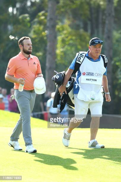 Tyrrell Hatton of England and his caddie Mick Donaghy walk down the fairway on the first during Day Four of the Turkish Airlines Open at The...