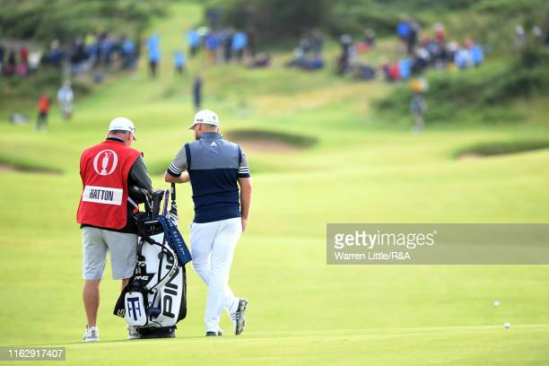 Tyrrell Hatton of England and his caddy Mick Donaghy on the second hole during the second round of the 148th Open Championship held on the Dunluce...
