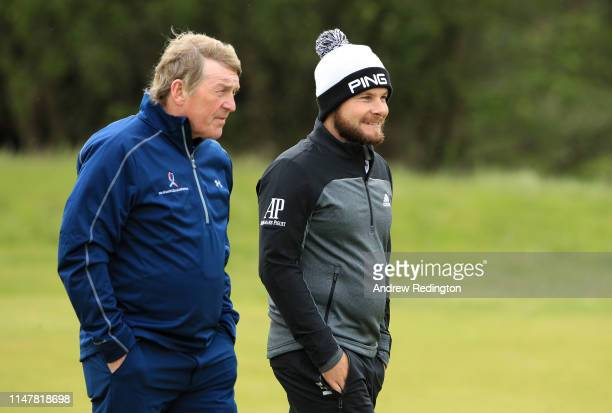 Tyrrell Hatton of England and Kenny Dalglish exfootballer in action during the Pro Am prior to the start of the Betfred British Masters at Hillside...