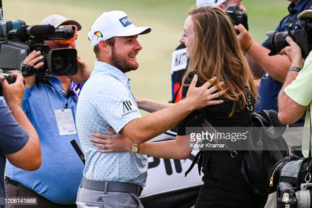 Tyrrell Hatton of England celebrates and hugs his fiancée Emily Braisher following his one stroke victory in the final round of the Arnold Palmer...