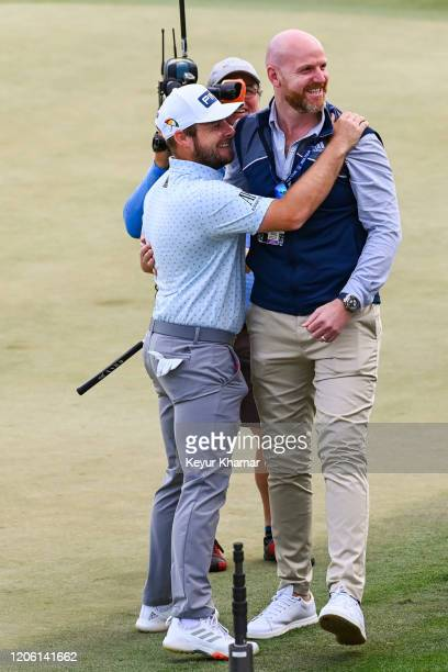 Tyrrell Hatton of England celebrates and hugs his manager Danny Wardrop following his one stroke victory in the final round of the Arnold Palmer...