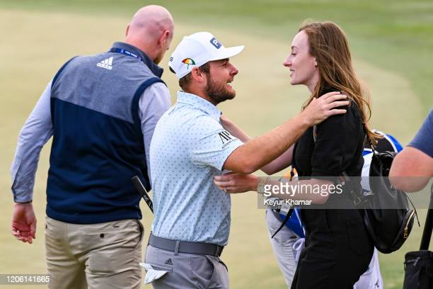 Tyrrell Hatton of England celebrates and kisses his fiancée Emily Braisher following his one stroke victory in the final round of the Arnold Palmer...