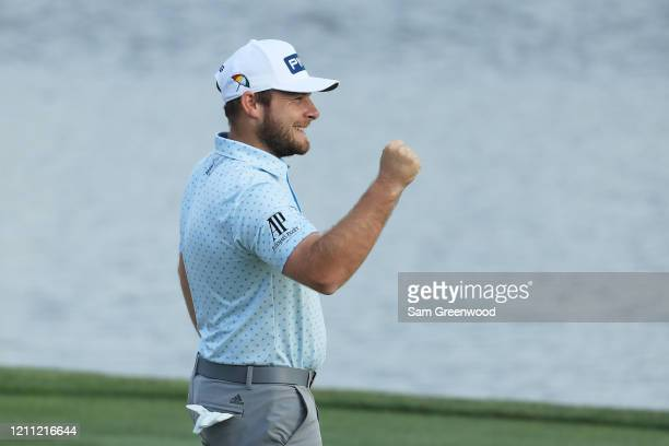 Tyrrell Hatton of England celebrates on the 18th green after winning during the final round of the Arnold Palmer Invitational Presented by MasterCard...