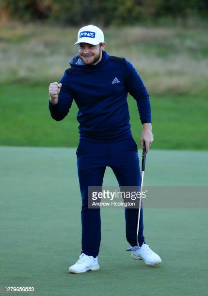 Tyrrell Hatton of England celebrates on the 18th green during Day Four of the BMW PGA Championship at Wentworth Golf Club on October 11, 2020 in...