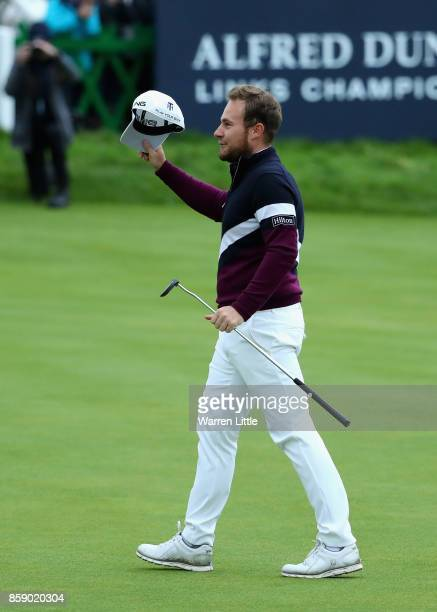 Tyrrell Hatton of England celebrates victory following the final round of the 2017 Alfred Dunhill Championship at The Old Course on October 8 2017 in...