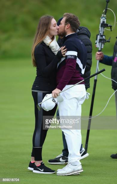 Tyrrell Hatton of England celebrates victory with his girlfriend Emily Braisher following the final round of the 2017 Alfred Dunhill Championship at...