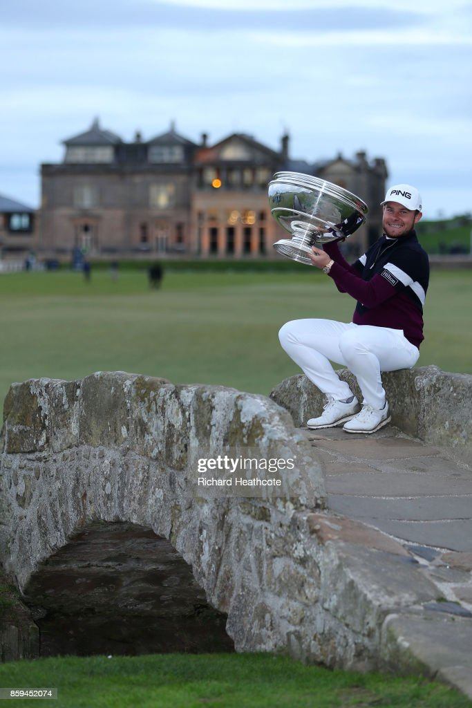 Tyrrell Hatton of England celebrates victory with the trophy on the Swilken Bridge following the final round of the 2017 Alfred Dunhill Championship at The Old Course on October 8, 2017 in St Andrews, Scotland.
