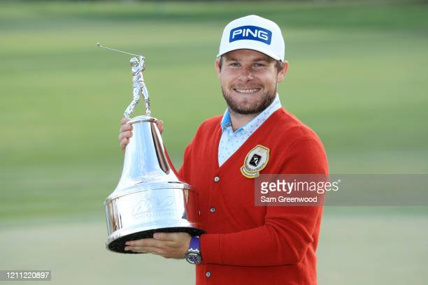 Tyrrell Hatton of England celebrates with the trophy after winning during the final round of the Arnold Palmer Invitational Presented by MasterCard...