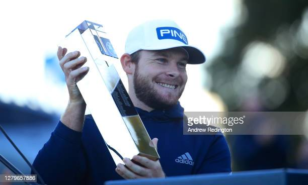 Tyrrell Hatton of England celebrates with the trophy following victory during Day Four of the BMW PGA Championship at Wentworth Golf Club on October...