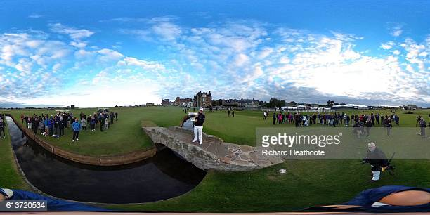Tyrrell Hatton of England celebrates with trophy on Silken Bridge on the 18th green after winning the Alfred Dunhill Links Championship at The Old...
