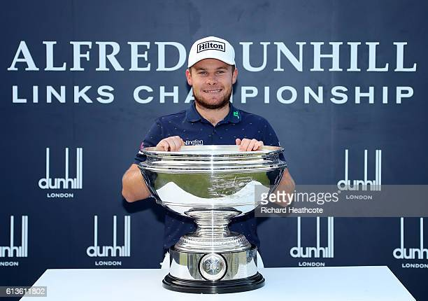 Tyrrell Hatton of England celebrates with trophy on the 18th green after winning the Alfred Dunhill Links Championship at The Old Course on October 9...