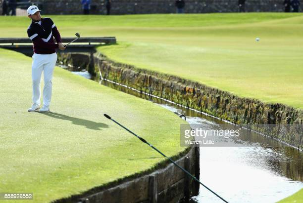Tyrrell Hatton of England chips in on the 1st hole during the final round of the 2017 Alfred Dunhill Championship at The Old Course on October 8 2017...