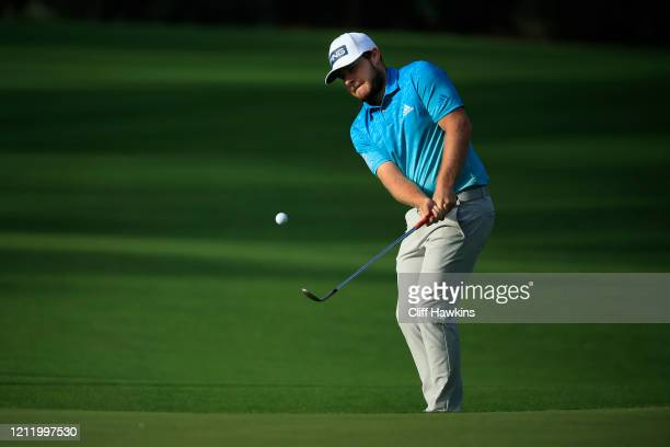 Tyrrell Hatton of England chips to the 10th green during the first round of The PLAYERS Championship on The Stadium Course at TPC Sawgrass on March...