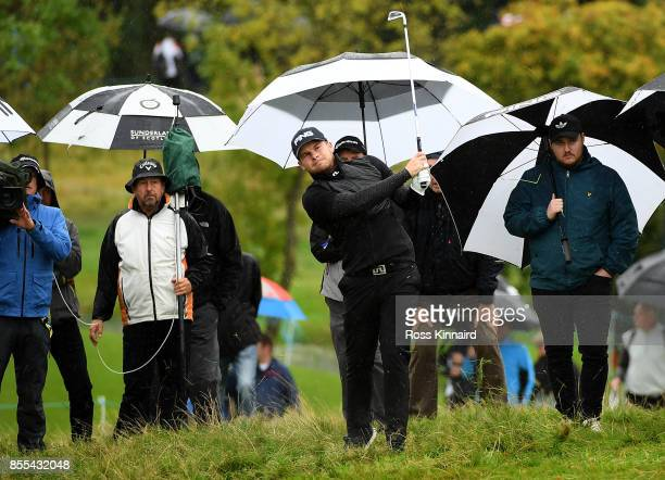 Tyrell Hatton of England hits his second shot on the 16th hole during day two of the British Masters at Close House Golf Club on September 29 2017 in...