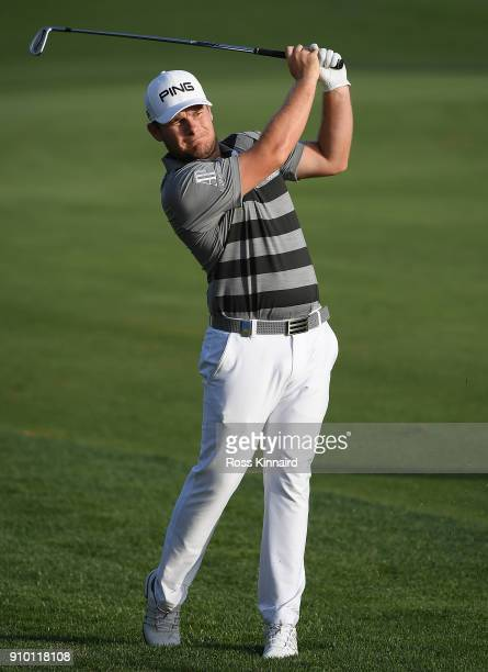Tyrell Hatton of England hits his second shot on the 18th hole during round one of the Omega Dubai Desert Classic at Emirates Golf Club on January 25...