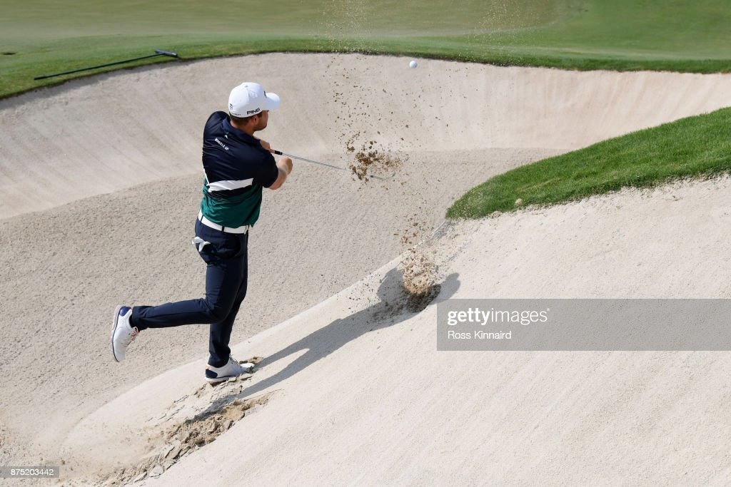 Tyrrell Hatton of England hits his third shot on the 18th hole during the second round of the DP World Tour Championship at Jumeirah Golf Estates on November 17, 2017 in Dubai, United Arab Emirates.