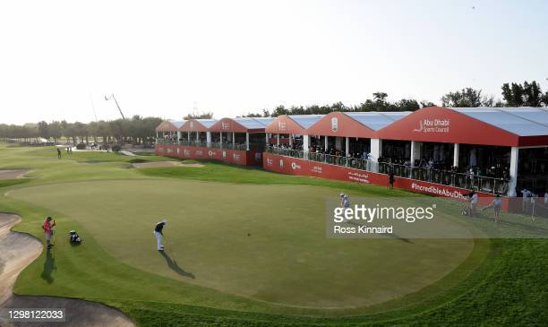 Tyrrell Hatton of England holes the winning putt 1during the final round of the Abu Dhabi HSBC Championship at Abu Dhabi Golf Club on January 24,...